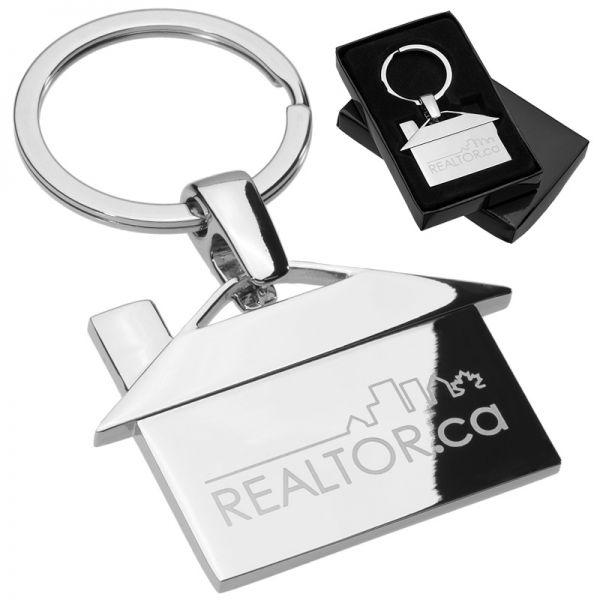 Custom laser engraved metal keychain shaped like a house